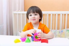 Happy little boy with educational toy Royalty Free Stock Photos