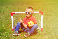 Happy little boy enjoy playing football Stock Images