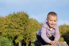 Happy little boy exploring outdoors Stock Image