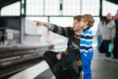 Happy little boy with father in a subway station. Royalty Free Stock Images