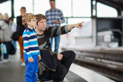 Happy little boy with father in a subway station. Stock Photo