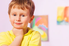 Happy little boy with fist near chin portrait Royalty Free Stock Photos