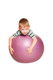Happy little boy with fitness ball. Stock Photo