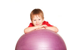 Happy little boy with fitness ball. Royalty Free Stock Photography