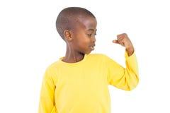 Happy little boy flexing arm Stock Image