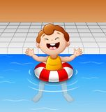 Happy little boy floating in swimming pool with inflatable circle Stock Images