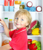 Happy little boy with food Royalty Free Stock Photo