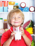 Happy little boy with food Stock Images