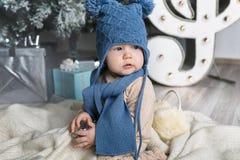 Happy little boy with fur headphones Stock Photos