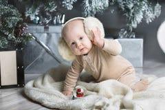Happy little boy with fur headphones Royalty Free Stock Photo