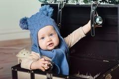 Happy little boy with fur headphones Stock Images
