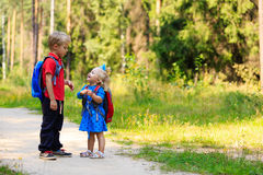 Happy little boy and girl with backpacks in summer Stock Photography
