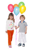 Happy little boy and girl with balloons Royalty Free Stock Photo