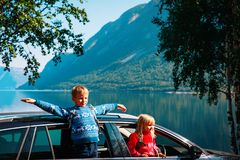 Happy little boy and girl enjoy travel by car in nature. Norway travel royalty free stock images