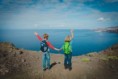 Happy little boy and girl enjoy travel in nature stock image