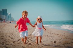 Happy little boy and girl run play at beach. Happy little boy and girl run play at tropical beach stock photography
