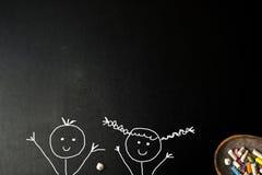 Happy little boy and girl stickman blackboard card. Royalty Free Stock Photo