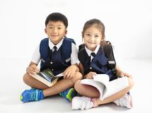 little boy and girl student studying Stock Images