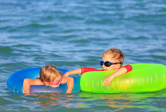 Happy little boy and girl swim at summer beach Royalty Free Stock Image