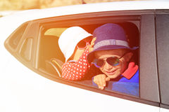 Happy little boy and girl travel by car Royalty Free Stock Photography