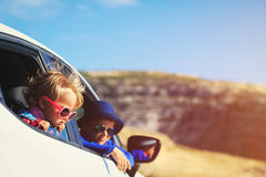 Happy little boy and girl travel by car in mountains Royalty Free Stock Images