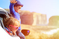 Happy little boy and girl travel by car in Stock Photography