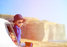 Happy little boy and girl travel by car in Royalty Free Stock Photography