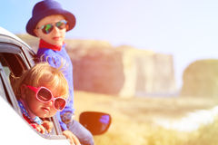 Happy little boy and girl travel by car in Stock Image