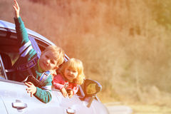 Happy little boy and girl travel by car Royalty Free Stock Image