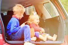 Happy little boy and girl travel by car Royalty Free Stock Images