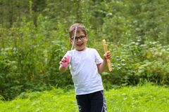 Happy little boy in glasses plays with soap bubbles. In summer forest Stock Image