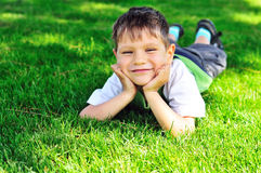 Happy little boy on the grass Stock Photography