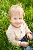 Happy little boy in grass Royalty Free Stock Images