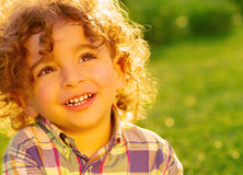Happy little boy on green grass Stock Images