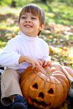 Happy little boy with halloween pumpkin Stock Photography