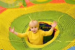 Happy little boy having fun in amusement in play center. Child playing on indoor playground. Active birthday party for preschooler kids stock images