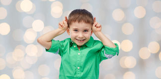 Happy little boy having fun and making horns Stock Photos