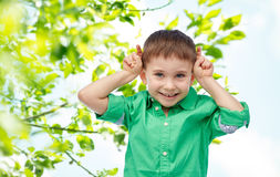 Happy little boy having fun and making horns Royalty Free Stock Images