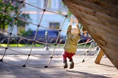Happy little boy having fun on outdoor playground Royalty Free Stock Images