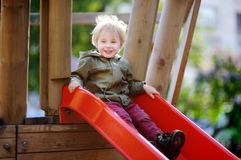 Happy little boy having fun on outdoor playground Stock Photography
