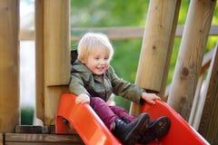Happy little boy having fun on outdoor playground Stock Photography