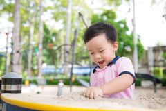 Happy little boy having fun at playground in summer. stock image
