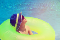 Happy little boy having fun at the pool. Or beach Royalty Free Stock Photos