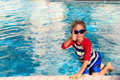 Happy little boy having fun at the pool. Cute happy little boy having fun at the pool Stock Photography