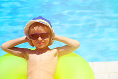 Happy little boy having fun at the pool. Summer vacation Royalty Free Stock Image