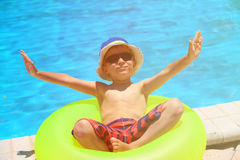 Happy little boy having fun at the pool. Summer vacation Stock Images