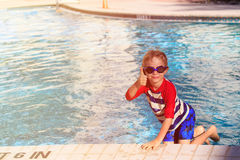 Happy little boy having fun at the pool. Happy little boy with thumb up having fun at the pool Stock Image