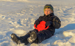 Happy little boy having fun in winter snow Stock Images