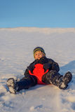 Happy little boy having fun in winter snow Stock Photos