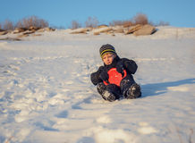 Happy little boy having fun in winter snow Royalty Free Stock Photos